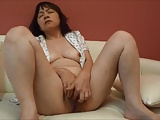 Horny Japanese milf Kui Somya fingering on the sofa 2